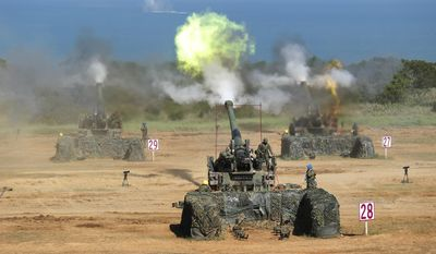 Taiwan's military fire artillery from M110A2 self-propelled Howitzers during the annual Han Kuang exercises in Hsinchu, north eastern Taiwan, Thursday, Sept. 10, 2015. Taiwan's military is simulating attacks by political rival China this week, despite an overall warming of ties, after Beijing staged what appeared to be a strike against the presidential office in Taipei. (AP Photo/Wally Santana)