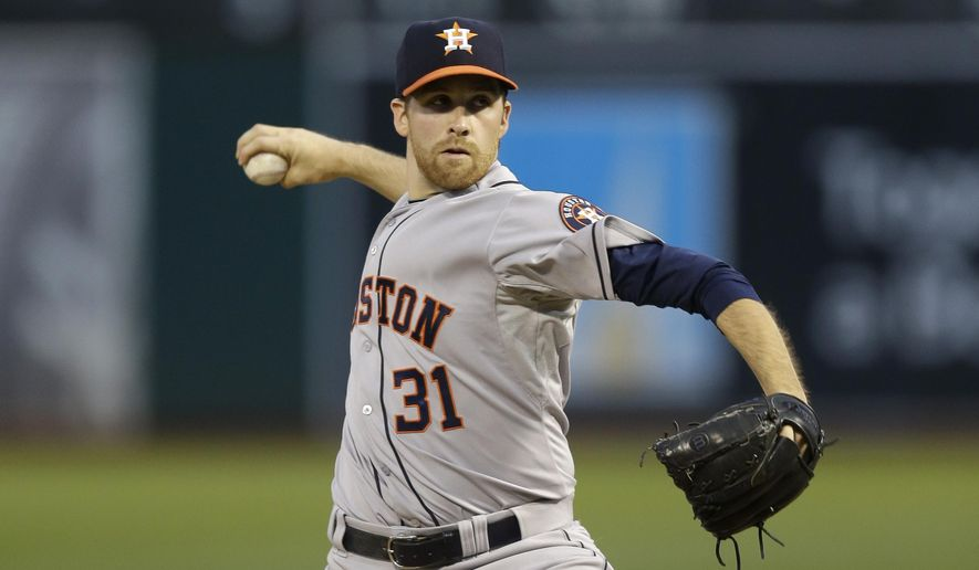 Houston Astros pitcher Collin McHugh works against the Oakland Athletics during the first inning of a baseball game Wednesday, Sept. 9, 2015, in Oakland, Calif. (AP Photo/Ben Margot)