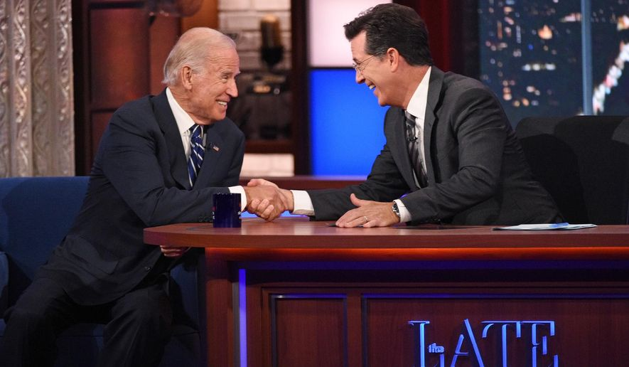 """In this image released by CBS, host Stephen Colbert, right, shakes hands with Vice President Joe Biden during a taping of """"The Late Show with Stephen Colbert,"""" on Thursday, Sept. 10, 2015 in New York. (John Paul Filo/CBS via AP) MANDATORY CREDIT; NO ARCHIVE; NO SALES; NORTH AMERICAN USE ONLY"""