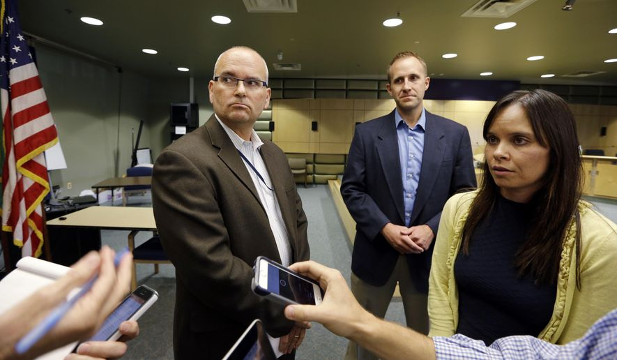 Seattle Public Schools bargaining team members Jon Halfaker, left, executive director of schools/Northwest region, Keven Wynkoop, Ballard High School principal, and spokesperson Stacy Howard answer further questions after a news conference about the teacher's strike, Wednesday, Sept. 9, 2015, in Seattle. Thousands of Seattle teachers marched on picket lines Wednesday as they went on strike for the first time in three decades amid increasing complaints that their salaries have not kept up with the city's booming tech economy. The walkout, which began on what was supposed to be the first day of school, comes as teachers in Seattle have gone six years without a cost-of-living increase, and many say they are scrambling to afford housing in a city where living expenses are rapidly increasing. (AP Photo/Elaine Thompson)