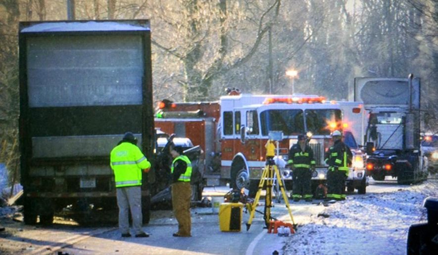 FILE - In this photo taken Jan. 24, 2014, crews investigate the scene of a double fatal crash involving a 12-ton semi-trailer loaded with groceries on U.S. 50, near state Route 222, in Stonelick Township, Ohio.  An Alabama company that made a tractor-trailer hitch involved in the deadly Ohio crash last year is bowing to government pressure and will recall 6,800 hitches. Fontaine Fifth Wheel of Trussville, Ala., agreed to the recall in August 2015,  according to documents posted Thursday, Sept. 10, 2015 by the National Highway Traffic Safety Administration. (Glenn Hartong/The Enquirer via AP) MANDATORY CREDIT;  NO SALES
