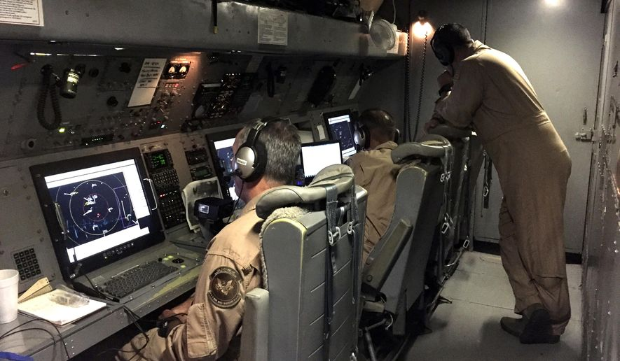 U.S. Customs and Border Protection agents work the radar aboard a P-3 surveillance flight on July 10, 2015, above the Caribbean. While the eastern Pacific Ocean remains the most popular route for cocaine smuggling, the Caribbean is again becoming a popular option decades after U.S. authorities all but shut down cocaine smuggling into South Florida in the notorious era of the cocaine cowboys that started in the 1970s.  (AP Photo/Alicia Caldwell)