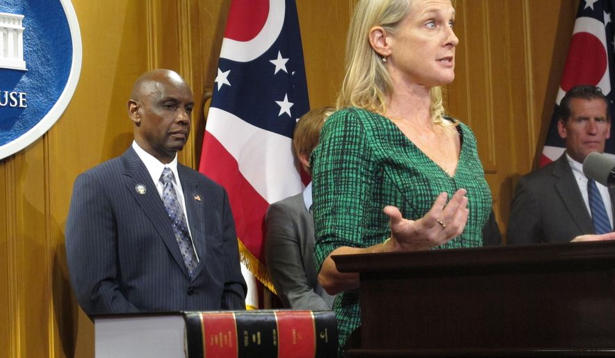 "Piper Kerman, an ex-felon whose memoir of her time behind bars, ""Orange is the New Black,"" is the basis for the hit Netflix show of the same name, promotes an effort to update Ohio's criminal code with a goal of reducing the state's incarceration rate and saving taxpayer dollars, on Thursday, Sept. 10, 2015, in Columbus, Ohio. Kerman, now a Columbus resident, teaches nonfiction writing to Ohio inmates. (AP Photo/Andrew Welsh-Huggins)"