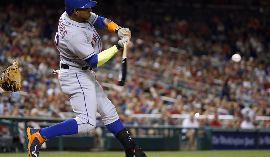 New York Mets' Yoenis Cespedes hits a two-run home run during the eighth inning of a baseball game against the Washington Nationals at Nationals Park, Wednesday, Sept. 9, 2015, in Washington. The Mets won 5-3. (AP Photo/Alex Brandon)