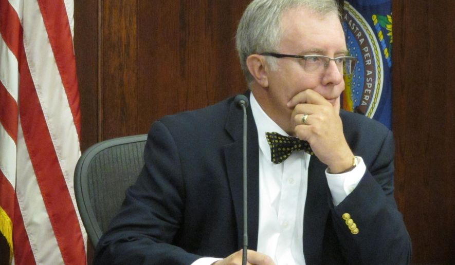 Kansas Corporation Commission member Jay Emler listens to a staffer's summary of an order increasing electric rates by 9 percent for Kansas City Power & Light's customers in the state's northeast corner, Thursday, Sept. 10, 2015, in Topeka, Kan. The commission has approved the rate-setting order. (AP Photo/John Hanna)
