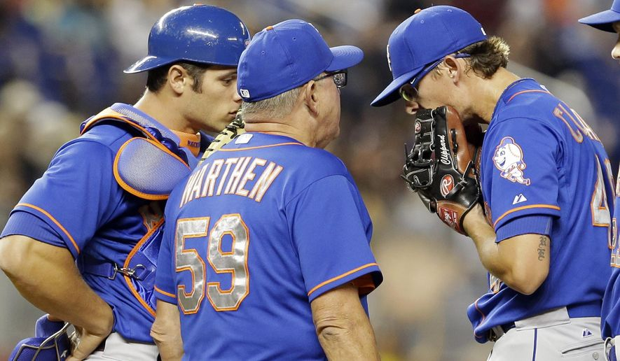 New York Mets pitching coach Dan Warthen (59) talks to relief pitcher Tyler Clippard, right, who gave up a hit to Miami Marlins' Dee Gordon in the ninth inning of a baseball game, Sunday, Sept. 6, 2015, in Miami. The Marlins won 4-3.  (AP Photo/Alan Diaz)