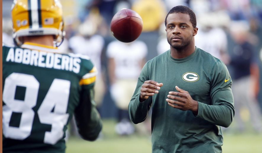 FILE - In this Sept. 3, 2015, file photo, Green Bay Packers' Randall Cobb smiles before a preseason NFL football game against the New Orleans Saints', in Green Bay, Wis.  Cobb is trying on some extra protection on his injured right shoulder. He's practicing falling so he doesn't fall on it. (AP Photo/Mike Roemer, File)