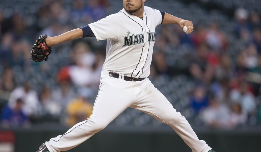 Seattle Mariners starter Vidal Nuno delivers a pitch during the first inning of a baseball game against the Texas Rangers, Wednesday, Sept. 9, 2015, in Seattle. (AP Photo/Stephen Brashear)