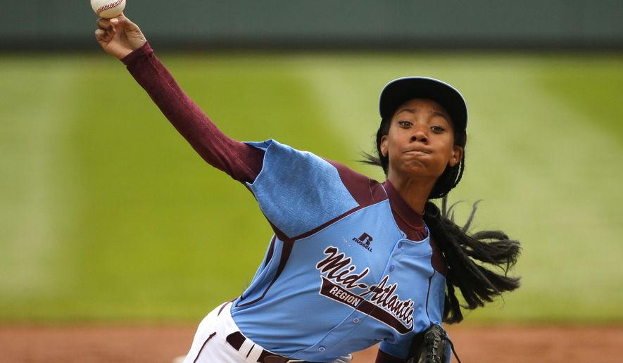 FILE - In this Aug. 15, 2014, file photo, Pennsylvania's 13-year-old Mo'ne Davis delivers in the first inning against Tennessee during a baseball game in United States pool play at the Little League World Series tournament in South Williamsport, Pa. Little League is getting younger. The organization announced Thursday, Sept. 10, 2015, it is changing its age requirement, phasing out 13-year-olds from the league. (AP Photo/Gene J. Puskar, File)