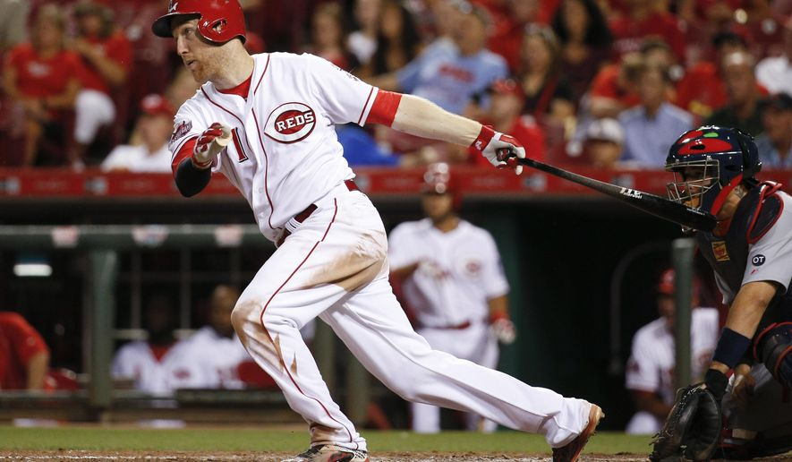 Cincinnati Reds' Todd Frazier hits an RBI-double off St. Louis Cardinals starting pitcher Jaime Garcia to drive in Joey Votto in the fifth inning of a baseball game, Thursday, Sept. 10, 2015, in Cincinnati. (AP Photo/John Minchillo)