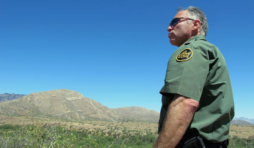 U.S. Border Patrol Tucson Sector Chief Manuel Padilla looks out over the desert terrain near Sasabe, Arizona. (associated press)