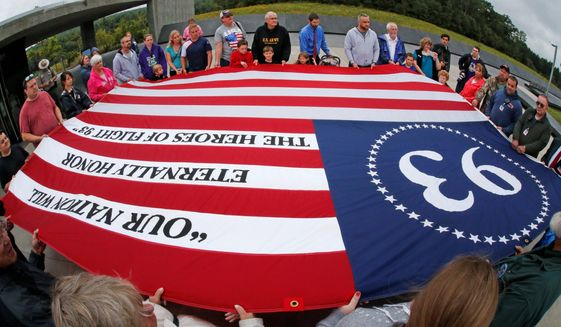 Visitors to the Flight 93 National Memorial in Shanksville, Pa., participate in a memorial service Thursday as the nation marks the 14th anniversary of the Sept. 11 attacks. (Associated Press)