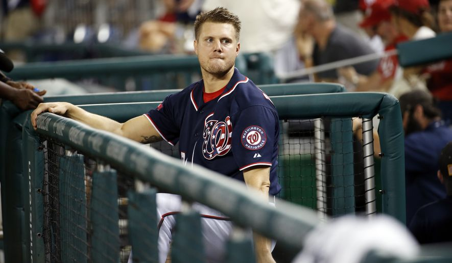 Washington Nationals relief pitcher Jonathan Papelbon holds onto the rail of the dugout as the New York Mets celebrate after a baseball game at Nationals Park, Wednesday, Sept. 9, 2015, in Washington. The Mets won 5-3. (AP Photo/Alex Brandon)