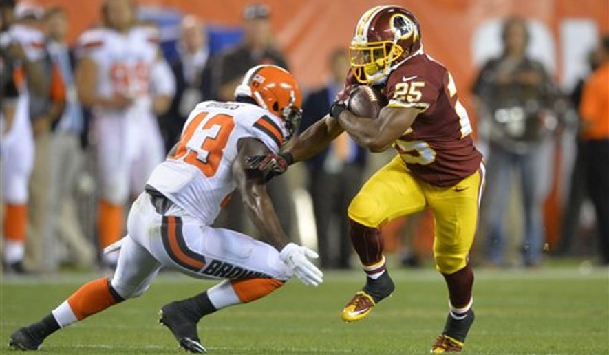 Washington Redskins running back Chris Thompson (25) breaks a tackle from Cleveland Browns cornerback Charles Gaines (43) in the third quarter of an NFL preseason football game Thursday, Aug. 13, 2015, in Cleveland. (AP Photo/David Richard)