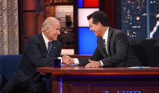 """Stephen Colbert (right) greets Vice President Joe Biden during a taping of """"The Late Show with Stephen Colbert,"""" on Thursday in New York. (CBS via Associated Press)"""