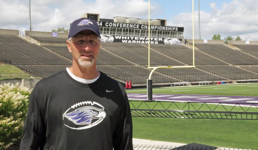 In this photo from Aug. 24, 2015, photo, Wisconsin-Whitewater football coach Kevin Bullis poses at Perkins Stadium in Whitewater, Wis. Bullis is taking over for Lance Leipold as head coach of a program that has won six of the last eight Division III national titles and the nation's longest current winning streak at 32 games. (AP Photo/Genaro C. Armas)
