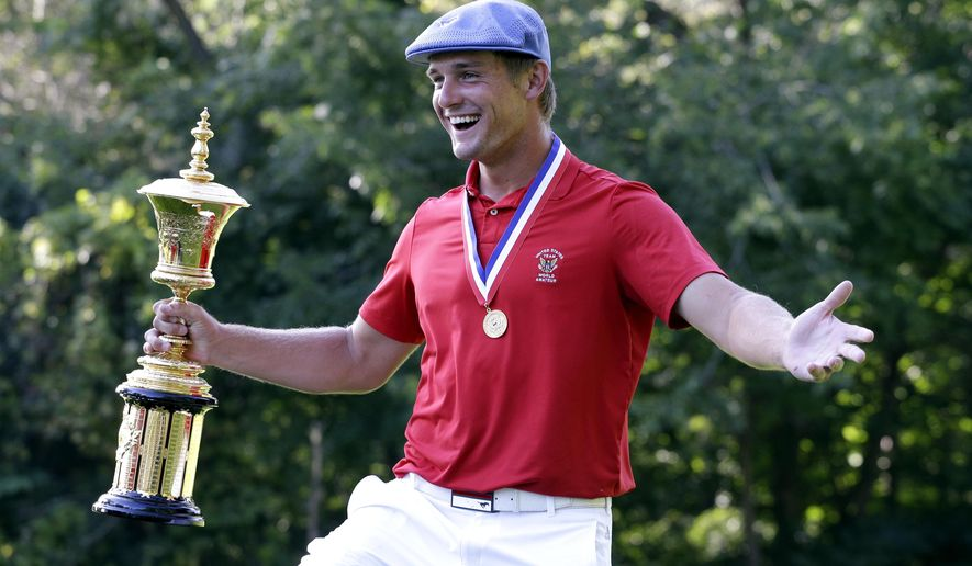 ADVANCE FOR WEEKEND EDITIONS, SEPT. 12-13 FILE - In this Aug. 23, 2015, file photo, Bryson DeChambeau celebrates after winning the 115th U.S. Amateur Championship golf match at Olympia Fields Country Club in Olympia Fields, Ill. (AP Photo/Nam Y. Huh, File)