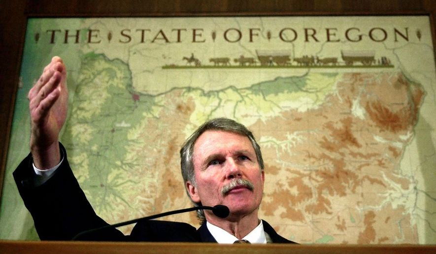 FILE - In this Feb. 11, 2002, file photo, Oregon Gov. John Kitzhaber talks about the legislative special session in the Capitol ceremonial office in Salem, Ore.  While finishing his second term as governor in 2002, Kitzhaber was bitter and discouraged about the state's leaders and its voters, according to newly released excerpts from his personal journal. (AP Photo/Don Ryan, File)