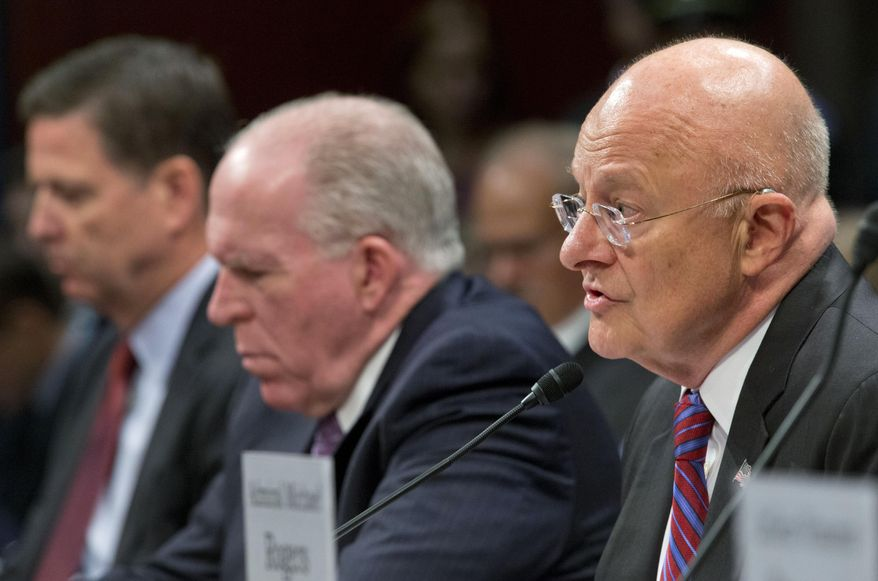 Director of National Intelligence James Clapper, right, with CIA Director John Brennan, center, and FBI Director James Comey, left, testifies on Capitol Hill in Washington, Thursday, Sept. 10, 2015, before the House Intelligence Committee hearing on cyberthreats. (AP Photo/Pablo Martinez Monsivais)