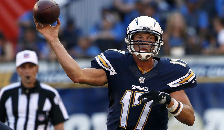 """ADVANCE FOR WEEKEND OF SEPT 12 & 13 - FILE - In this Aug. 29, 2015, file photo, San Diego Chargers quarterback Philip Rivers throws against the Seattle Seahawks during the first half of an NFL preseason football game in San Diego. Rivers will be throwing passes to Keenan Allen and Stevie Johnson, and Melvin Gordon will be looking for holes behind the """"Mayflower Line"""" when the Chargers host the Detroit Lions in a season opener Sunday, Sept. 13, 2015, at aging Qualcomm Stadium, the epicenter for angst among local football fans. (AP Photo/Lenny Ignelzi, File)"""