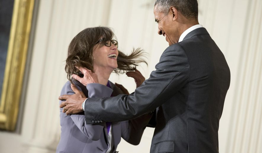 President Barack Obama awards the 2014 National Medal of Arts to actress and filmmaker Sally Field of Los Angles during a ceremony in the East Room at the White House in Washington, Thursday, Sept. 10, 2015. (AP Photo/Andrew Harnik)