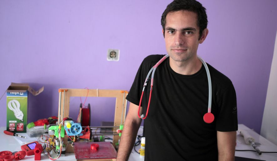 In this Monday, Sept. 7, 2015 photo, Dr. Tarek Loubani, a Palestinian-Canadian doctor, poses for a picture with 3D printed stethoscope around his neck, in Gaza City. In a territory lacking many basic medical supplies, Dr. Tarek Loubani says he has designed a stethoscope that can be made by a 3-D printer for just $2.50 _ a fraction of the cost of leading brands. Some doctors say the equipment is just as good.  (AP Photo/ Khalil Hamra)