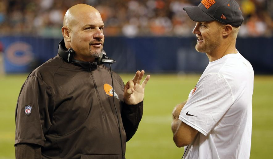 FILE - In this Sept. 3, 2015, file phto, Cleveland Browns head coach Mike Pettine talks to Cleveland Browns quarterback Josh McCown during the second half of an NFL preseason football game against the Chicago Bears in Chicago. At 36, Browns quarterback Josh McCown knows his days as an NFL quarterback are numbered, which is why he savors every snap.(AP Photo/Charles Rex Arbogast, File)