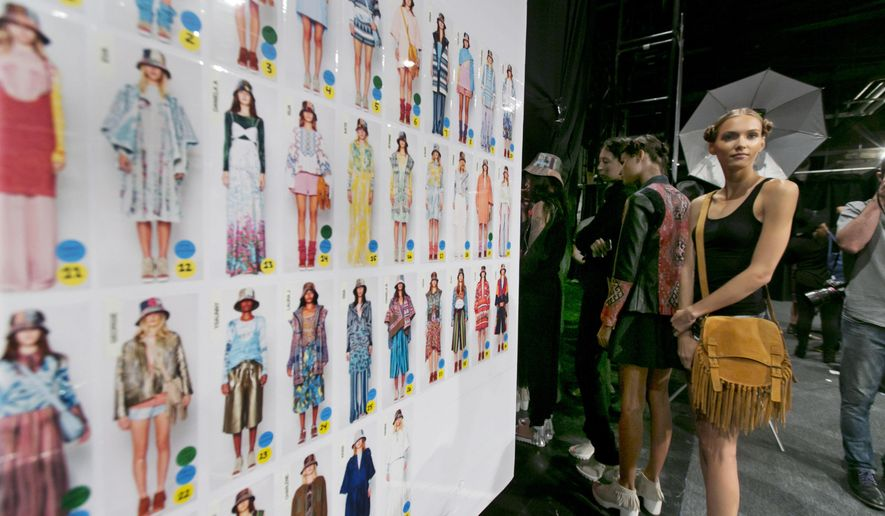 Models wait for the rehearsal backstage before the BCBG MAX AZRIA Spring 2016 collection is modeled during Fashion Week in New York, Thursday, Sept. 10, 2015. (AP Photo/Richard Drew)