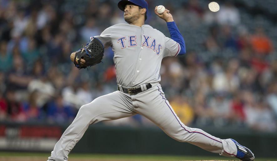 Texas Rangers starter Martin Perez delivers a pitch during the first inning of a baseball game against the Seattle Mariners, Wednesday, Sept. 9, 2015, in Seattle. (AP Photo/Stephen Brashear)