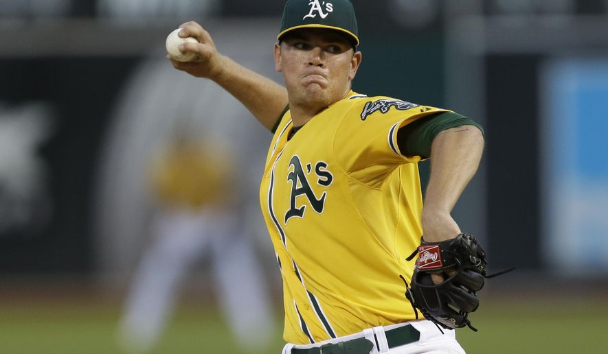Oakland Athletics pitcher Aaron Brooks works against the Houston Astros during the first inning of a baseball game Wednesday, Sept. 9, 2015, in Oakland, Calif. (AP Photo/Ben Margot)