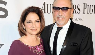 """In this June 8, 2014, file photo, Gloria Estefan, left, and Emilio Estefan pose for photos at the 68th annual Tony Awards at Radio City Music Hall in New York. The veteran producer Emilio Estefan says he wrote a song called """"We're All Mexican"""" to celebrate the achievements of Hispanic people in the U.S. Speaking in Spanish on his Facebook page Thursday, Sept. 10, 2015, Estefan said the song is a way to """"show the world the pride we have, not just for the Hispanic community, but all Mexicans for all they have done for this country."""" (Photo by Charles Sykes/Invision/AP, File)"""