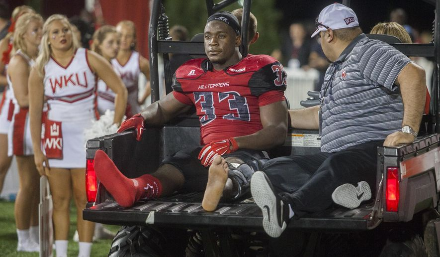 Western Kentucky running back Leon Allen is taken out of the stadium after a leg injury during Western Kentucky's 41-38 win over Louisiana Tech in an NCAA college football game Thursday, Sept. 10, 2015, in Bowling Green, Ky. (Austin Anthony/Daily News via AP)