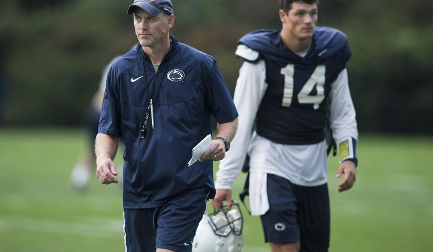 Penn State offensive coordinator John Donovan and quarterback Christian Hackenberg head off the field following football practice, Wednesday, Sept. 9, 2015 in State College, Pa. (Joe Hermitt/PennLive.com via AP) MANDATORY CREDIT