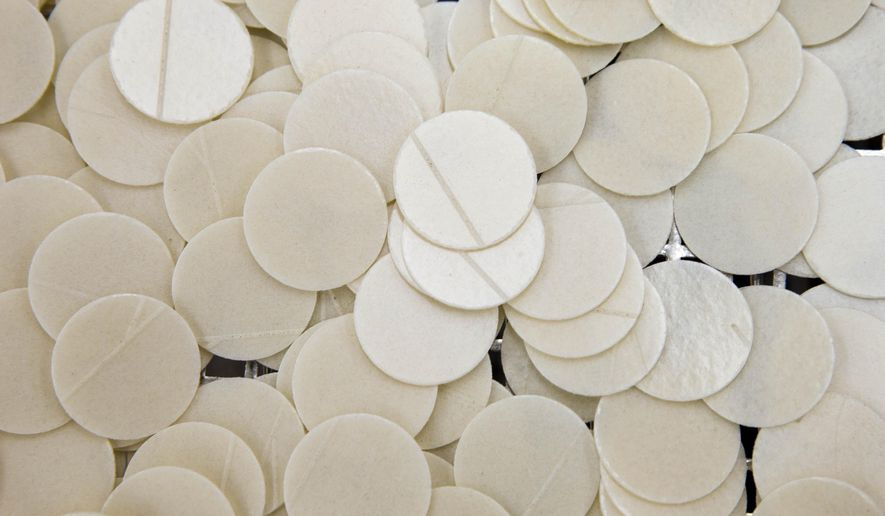 Shown are altar bread also known as communion wafers made by Poor Clares nuns, Tuesday, Sept. 8, 2015, at the Monastery of Saint Clare in Langhorne, Pa. The nuns are helping to supply wafers for the scheduled Mass being celebrated by Pope Francis on Sept. 27. (AP Photo/Matt Rourke)
