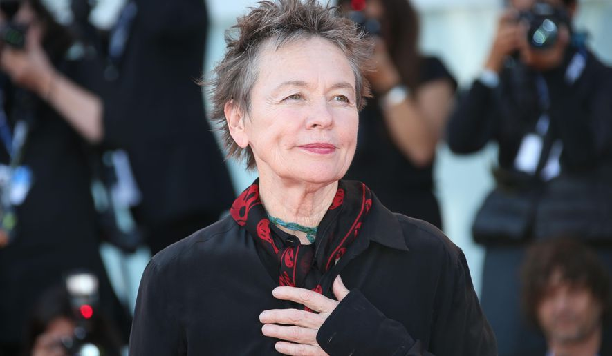 Laurie Anderson poses for photographers as she walks the red carpet for the film Heart of a Dog, during the 72nd edition of the Venice Film Festival in Venice, Italy, Wednesday, Sept. 9, 2015. The 72nd edition of the festival runs until Sept. 12. (Photo by Joel Ryan/Invision/AP)