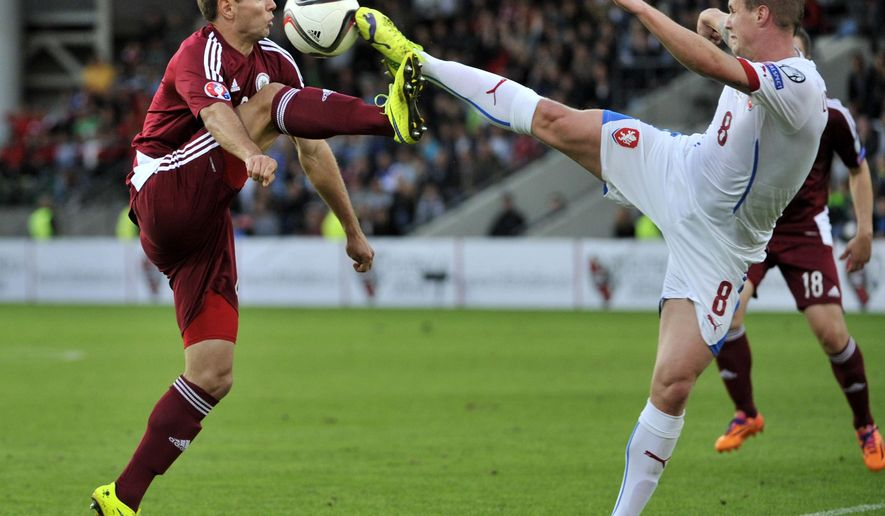 Latvia's Vladislavs Gabovs, left, and Czech Republic's David Limbersky fight for the ball during a Euro 2016 qualifying Group A soccer match between Latvia and  Czech Republic in Riga, Latvia, Sunday, Sept. 6, 2015. (AP Photo/Roman Koksarov)