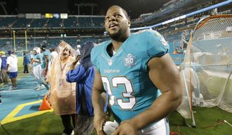 Miami Dolphins defensive tackle Ndamukong Suh (93) walks off the field at the end of an NFL preseason football game against the Atlanta Falcons, Saturday, Aug. 29, 2015 in Miami Gardens, Fla. The Dolphins defeated the Falcons 13-9. (AP Photo/Wilfredo Lee)