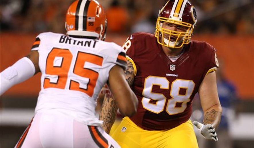 Washington Redskins tackle Tom Compton (68) against Cleveland Browns defensive end Armonty Bryant (95) during an NFL preseason football game, Thursday, Aug. 13, 2015, in Cleveland. (AP Photo/Ron Schwane)