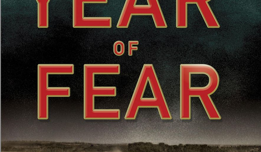 "This photo provided by Minotaur Books shows the cover of the book, ""The Year of Fear: Machine Gun Kelly and the Manhunt that Changed the Nation,"" by author Joe Urschel. (Minotaur Books via AP)"