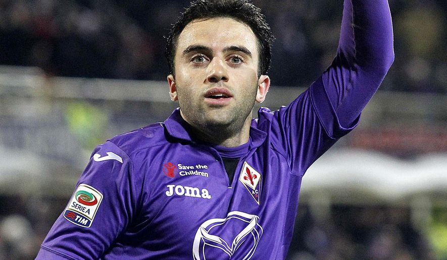 FILE - In this Monday, Dec. 2,  2013 file photo, Fiorentina's Giuseppe Rossi celebrates after scoring during a Serie A soccer match between Fiorentina and Verona at the Artemio Franchi stadium in Florence, Italy. Having just returned from the latest in a series of serious knee injuries, United States-born Italy international Giuseppe Rossi has agreed to reduce his salary at Fiorentina. Coach Paulo Sousa announced Friday, Sept. 11, 2015 that Rossi will make his first start of the season against Genoa on Saturday. (AP Photo/Fabrizio Giovannozzi, File)