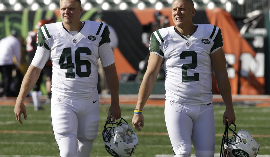 FILE - In this Oct. 27, 2013, file photo, New York Jets long snapper Tanner Purdum (46) and kicker Nick Folk (2) walk onto the field prior to an NFL football game against the Cincinnati Bengals in Cincinnati. Despite their importance, long snappers are often overlooked by fans _ and not easily recognized in the local grocery store like, say, quarterbacks or wide receivers. (AP Photo/Al Behrman, File)