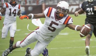 Virginia Tech's  Erikk Banks (5) tries to stay in bounds and score but falls short during the second half an NCAA college football game against Furman's Nick Miller, Saturday, Sept. 12, 2015, at Lane Stadium in Blacksburg, Va. Virginia Tech won 42-3. (Don Petersen/Roanoke Times via AP) LOCAL TELEVISION OUT; SALEM TIMES REGISTER OUT; FINCASTLE HERALD OUT;  CHRISTIANBURG NEWS MESSENGER OUT; RADFORD NEWS JOURNAL OUT; ROANOKE STAR SENTINEL OUT; MANDATORY CREDIT