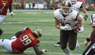 Bowling Green tight end Derek Lee (83) runs for end zone for a touchdown past Maryland defensive lineman Quinton Jefferson (99) during the first half of an NCAA college football game, Saturday, Sept. 12, 2015, in College Park, Md. (AP Photo/Nick Wass)
