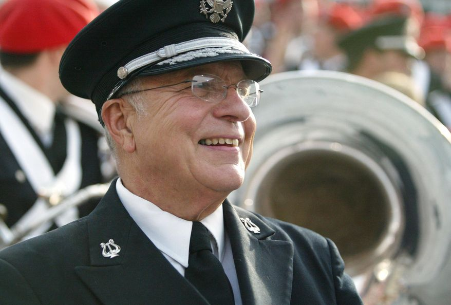 In this Oct. 9, 2004 photo, Dr. Jon Woods, then director of The Ohio State University Marching Band, watches the Ohio State-Wisconsin game in Columbus, Ohio. Woods, the longest-serving director of the band, died on Saturday, Sept. 12, 2015 according to the university. He was 76. Woods spent 28 years directing the marching band until his retirement after the 2011-12 academic year. (Lisa Marie Miller/Columbus Dispatch Photo via AP)