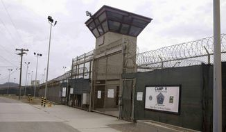 This June 7, 2014, file photo show the entrance to Camp 5 and Camp 6 at the U.S. military's Guantanamo Bay detention center, at Guantanamo Bay Naval Base, Cuba. (AP Photo/Ben Fox, File) **FILE**