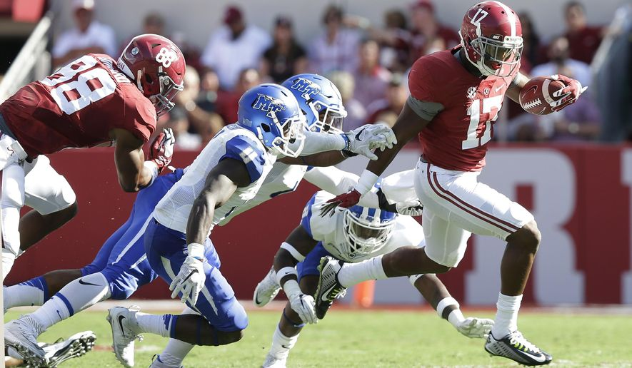 Alabama running back Kenyan Drake (17) runs the ball in for a touchdown in the first half during an NCAA college football game against Middle Tennessee, Saturday, Sept. 12, 2015, in Tuscaloosa, Ala. (AP Photo/Brynn Anderson)