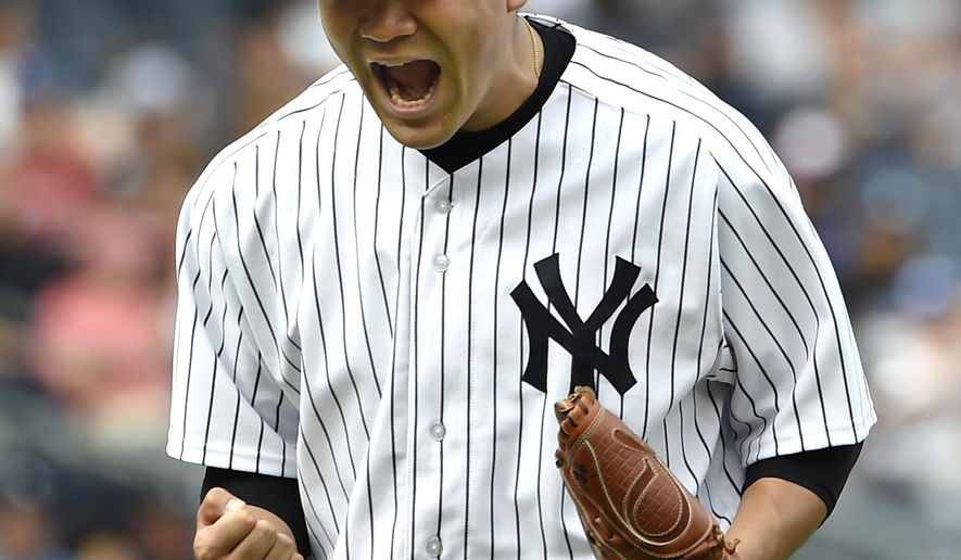 New York Yankees starting pitcher Masahiro Tanaka reacts after getting Toronto Blue Jays' Kevin Pillar to fly out for the third out in the seventh inning of a baseball game at Yankee Stadium, Sunday, Sept. 13, 2015, in New York. The Yankees won 5-0. (AP Photo/Kathy Kmonicek)