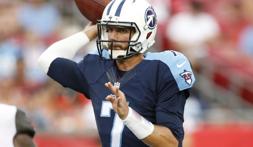 Tennessee Titans quarterback Marcus Mariota (8) looks to pass during the second half of an NFL football game against the Tampa Bay Buccaneers, Sunday, Sept. 13, 2015, in Tampa, Fla. The Titans defeated the Bucs 42-14. (AP Photo/Brian Blanco)