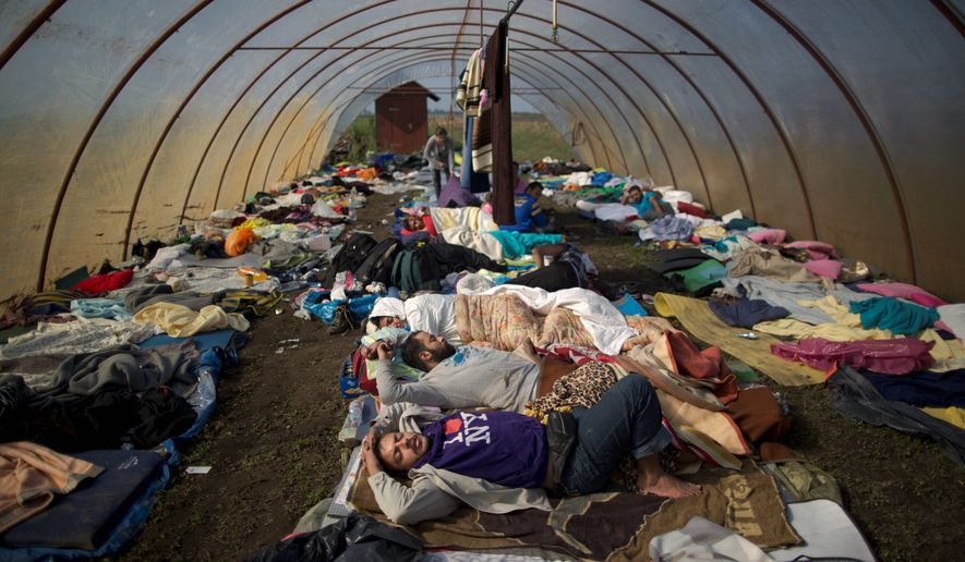 Syrian refugees sleep inside a greenhouse at a makeshift camp near Roszke, Hungary, on Sunday. The U.S. and many European countries are facing internal political pressures regarding the influx of migrants, seen by many right-wing fringe groups as suspect or even extremists. (Associated Press)