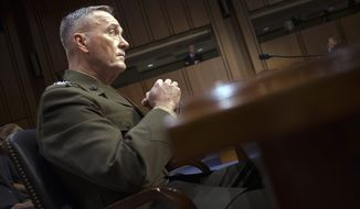 """Marine Corps Gen. Joseph Dunford, during Senate confirmation hearings in July, appears to be the first military official to use the 500 fatality figure, attributing it to Iranian """"activities."""" (Associated Press)"""